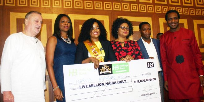 """Marshal-Idio clinches Heritage Bank's N5m Star Prize at The Next Titan Season-3 A budding entrepreneur with unique business idea of turning trashes into beautiful furniture, Mrs. Marvis Marshal-Idio has won the Heritage Bank's sponsored entrepreneurial competition show, Next Titan Season 3. The star prize is N5 million from Heritage Bank, which is the headline official sponsor of the competition and a brand new car from Coscharis Motors. At the grand finale held , weekend in Lagos, four finalists: Ronald Ajiboye, a first class graduate of a Russian University who is into drones production, Mrs. Marvis Marshal-Idio emerged winner,  Victoria Mamza, founder of Wangarau Foods was the 1st runner-up founder and Sunday Ewolabi of Naija Peanuts emerged as the 2nd runner-up. Impressed by the commitment and tenacity shown by contestants in this year's edition of The Next Titan, Nigeria's Entrepreneurial Reality TV Show, Heritage Bank Limited has restated its commitment for the Small and Medium Scale Enterprises (SMEs) in Nigeria. The bank said the scheme is a veritable platform through which the financial institution is propagating its campaign for youth empowerment programme in the country. Mr. Ife Sekibo, the Managing Director of the bank, who was represented by Mrs. Ori Ogba, Divisional Head, SME & Retail, Heritage Bank; at the final of the Season 3 of The next Titan held in Lagos on Sunday, said he was satisfied with the degree of commitment shown by each contestant who participated in the competition. Meanwhile, Sekibo said Heritage Bank instituted The Next Titan with a view to igniting the entrepreneurial spirit in the youth. His words: """"At Heritage Bank, we have discovered that SMEs have a crucial role to play in nation building process anywhere in the world. This is why at Heritage Bank we shall not relent in our support for young entrepreneurs who have a clear projection of their future plans."""" He stated that that the bank's participation the Next Titan TV Reality Sh"""