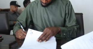 9ice signing his contract with Temple Management Company
