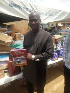 Hon. Wale Raji holding one of the donated books