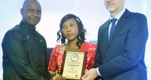 R-L: The Managing Director, Promasidor Nigeria Limited, Mr. Olivier Thiry presenting 20 years service award to Mr. Ossaiku Clifford of Workshop Department, accompanied by his wife, during Promasidor Nigeria Limited long service awards held at Promasidor Nigeria Limited.