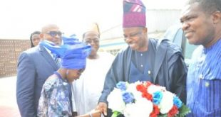 FROM LEFT TO RIGHT – Governor Ibikunle Amosun of Ogun State receiving a bouquet of flowers as he arrived for the commissioning of the upgraded  Ota Brewery on Wednesday. With him are the Chairman, Nigerian Breweries Plc, Chief Kola Jamodu (second left); Corporate Affairs Adviser, Nigerian Breweries Plc, Mr. Kufre Ekanem, (first from left) and Otunba Bimbo Ashiru, Ogun State Commissioner for Commerce and Industry.