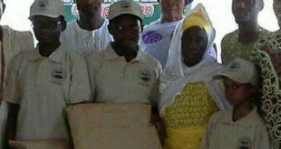 Victorious students from Epe local Government flanked by family members