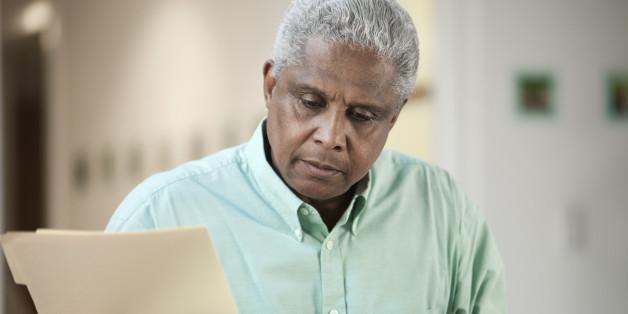 Black man holding folder